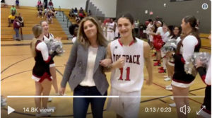 Brittany Wagner walks out Senior on Senior Night